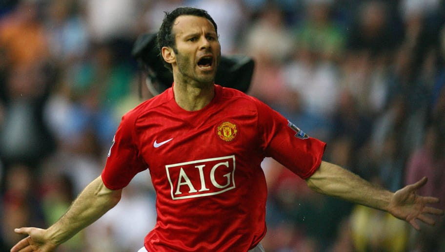 Manchester United's Welsh midfielder Ryan Giggs celebrates scoring the second goal against Wigan Athletic in their English Premier League football match at The JJB Stadium in Wigan, northwest England, on May 11, 2008. AFP PHOTO/PAUL ELLIS - Mobile and website use of domestic English football pictures are subject to obtaining a Photographic End User Licence from Football DataCo Ltd Tel : +44 (0) 207 864 9121 or e-mail accreditations@football-dataco.com - applies to Premier and Football League matches. (Photo credit should read PAUL ELLIS/AFP/Getty Images)