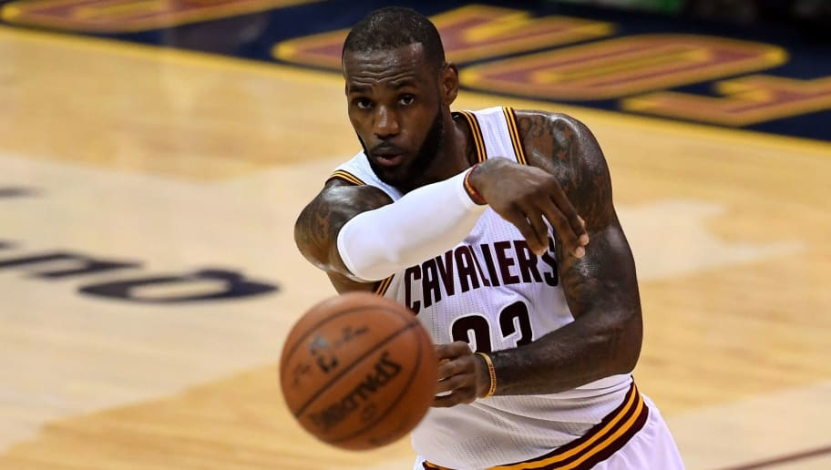 CLEVELAND, OH - JUNE 16:  LeBron James #23 of the Cleveland Cavaliers passes the ball during the first half against the Golden State Warriors in Game 6 of the 2016 NBA Finals at Quicken Loans Arena on June 16, 2016 in Cleveland, Ohio. NOTE TO USER: User expressly acknowledges and agrees that, by downloading and or using this photograph, User is consenting to the terms and conditions of the Getty Images License Agreement.  (Photo by Jason Miller/Getty Images)