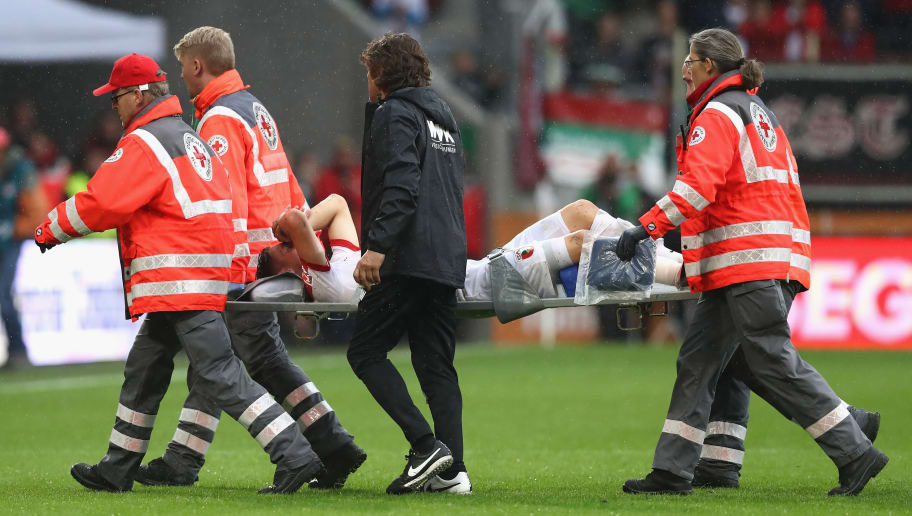 AUGSBURG, GERMANY - SEPTEMBER 18:  Medical staf help Dominik Kohr of Augsburg  after being injured during the Bundesliga match between FC Augsburg and 1. FSV Mainz 05 at WWK Arena on September 18, 2016 in Augsburg, Germany.  (Photo by Alexander Hassenstein/Bongarts/Getty Images)