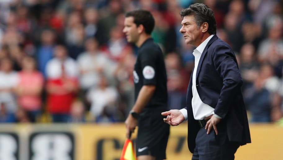 Watford's Italian head coach Walter Mazzarri looks on during the English Premier League football match between Watford and Manchester United at Vicarage Road Stadium in Watford, north of London on September 18, 2016. / AFP / Adrian DENNIS / RESTRICTED TO EDITORIAL USE. No use with unauthorized audio, video, data, fixture lists, club/league logos or 'live' services. Online in-match use limited to 75 images, no video emulation. No use in betting, games or single club/league/player publications.  /         (Photo credit should read ADRIAN DENNIS/AFP/Getty Images)