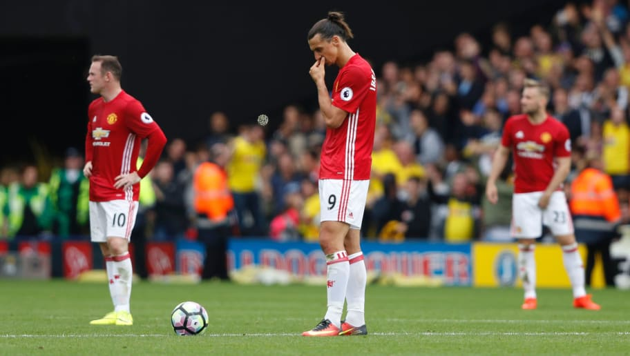 Manchester United's Swedish striker Zlatan Ibrahimovic (C) waits to re-start the match after Watford scored their second goal during the English Premier League football match between Watford and Manchester United at Vicarage Road Stadium in Watford, north of London on September 18, 2016. / AFP / Adrian DENNIS / RESTRICTED TO EDITORIAL USE. No use with unauthorized audio, video, data, fixture lists, club/league logos or 'live' services. Online in-match use limited to 75 images, no video emulation. No use in betting, games or single club/league/player publications.  /         (Photo credit should read ADRIAN DENNIS/AFP/Getty Images)