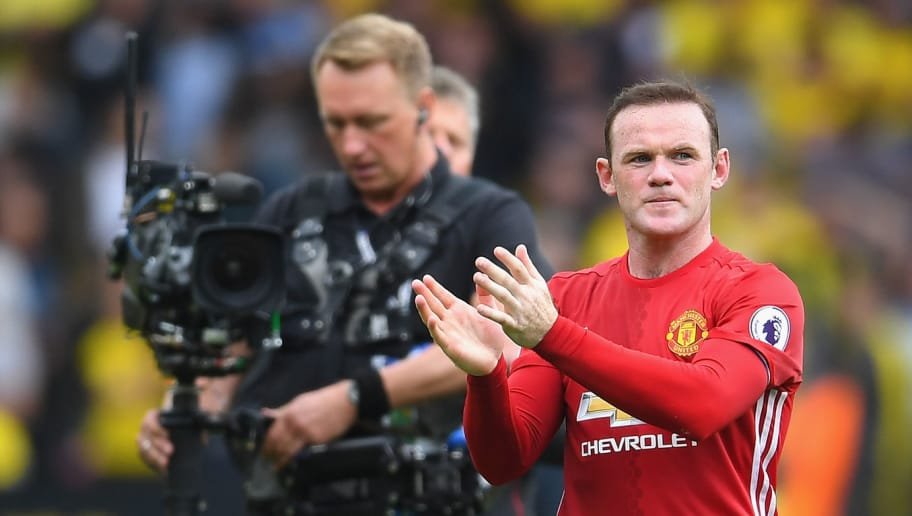 WATFORD, ENGLAND - SEPTEMBER 18: Wayne Rooney of Manchester United claps the fans while making his way off the pitch during the Premier League match between Watford and Manchester United at Vicarage Road on September 18, 2016 in Watford, England.  (Photo by Laurence Griffiths/Getty Images)