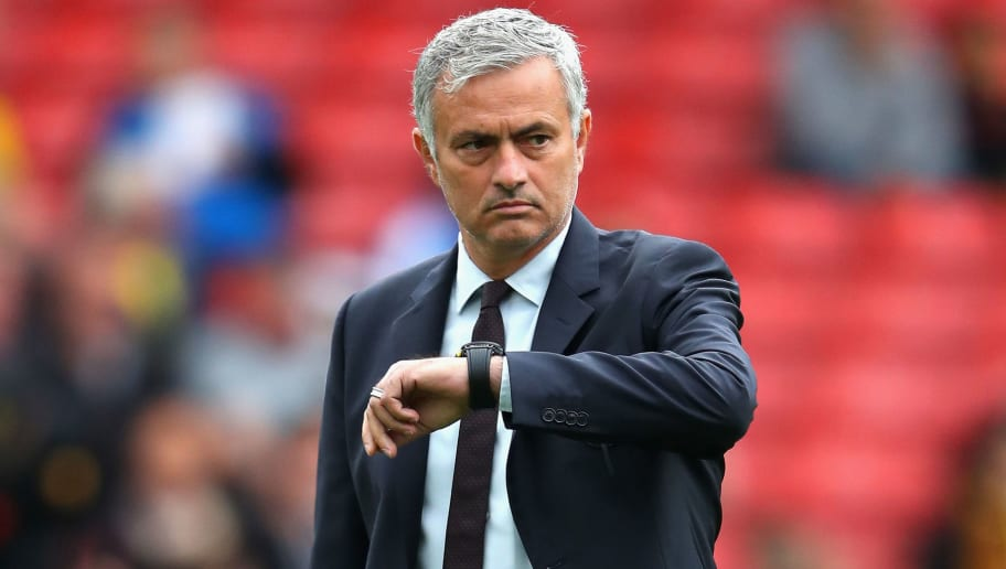 WATFORD, ENGLAND - SEPTEMBER 18: Jose Mourinho, Manager of Manchester United checks his watch as it approaches kick off during the Premier League match between Watford and Manchester United at Vicarage Road on September 18, 2016 in Watford, England.  (Photo by Richard Heathcote/Getty Images)