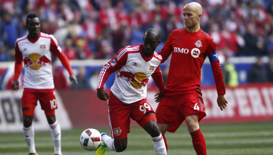 HARRISON, NJ - MARCH 6:  Bradley Wright-Phillips #99 of New York Red Bulls moves the ball by Michael Bradley #4 of Toronto FC during their match at Red Bull Arena on March 6, 2016 in Harrison, New Jersey.  (Photo by Jeff Zelevansky/Getty Images)