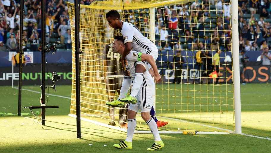 CARSON, CA - SEPTEMBER 11:  Robbie Keane #7 of Los Angeles Galaxy celebrates his goal with Giovani dos Santos #10 to take a 4-1 lead over the Orlando City FC at StubHub Center on September 11, 2016 in Carson, California.  (Photo by Harry How/Getty Images)