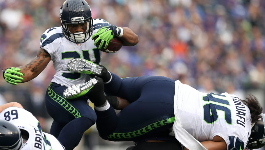 BALTIMORE, MD - DECEMBER 13: Running back Thomas Rawls #34 of the Seattle Seahawks carries the ball while teammate fullback Will Tukuafu #46 blocks against the Baltimore Ravens in the first quarter that M&T Bank Stadium on December 13, 2015 in Baltimore, Maryland. (Photo by Patrick Smith/Getty Images)