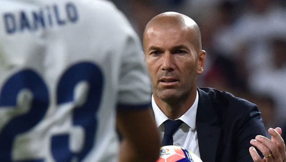 Real Madrid's French coach Zinedine Zidane passes the ball during the Spanish league football match Real Madrid CF vs Villarreal CF at the Santiago Bernabeu stadium in Madrid on September 21, 2016. / AFP / GERARD JULIEN        (Photo credit should read GERARD JULIEN/AFP/Getty Images)