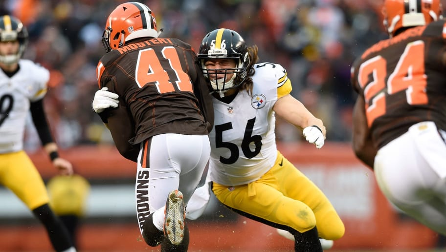CLEVELAND, OH - JANUARY 3:  Anthony Chickillo #56 of the Pittsburgh Steelers tackles Raheem Mostert #41 of the Cleveland Browns during the third quarter at FirstEnergy Stadium on January 3, 2016 in Cleveland, Ohio.  (Photo by Jason Miller/Getty Images)