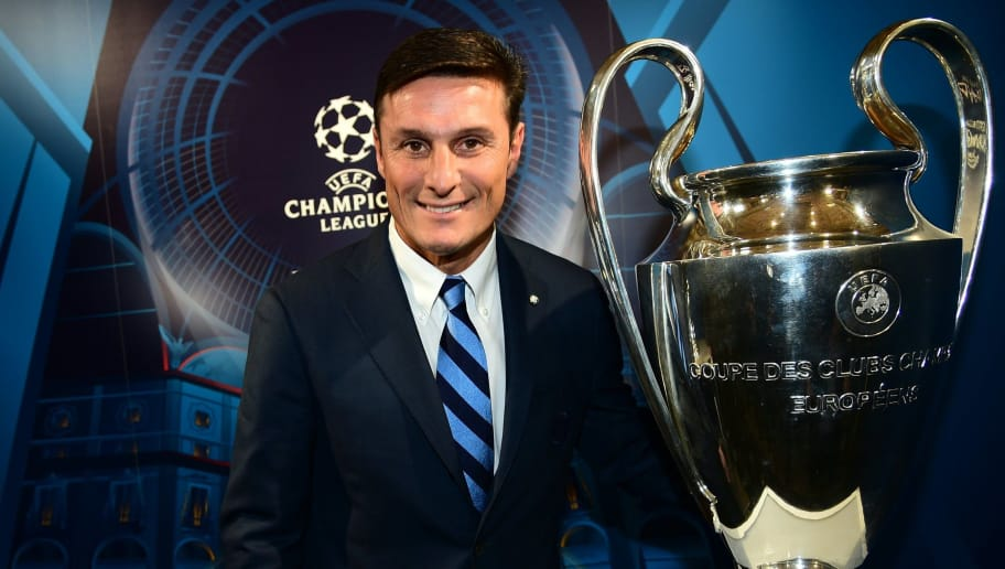 Former Inter Milan player Xavier Zanetti poses next to the UEFA Champions League Cup in Milan, northern Italy on April 22, 2016. The UEFA Champions league final will be played in Milan on 28 May.  / AFP / GIUSEPPE CACACE        (Photo credit should read GIUSEPPE CACACE/AFP/Getty Images)
