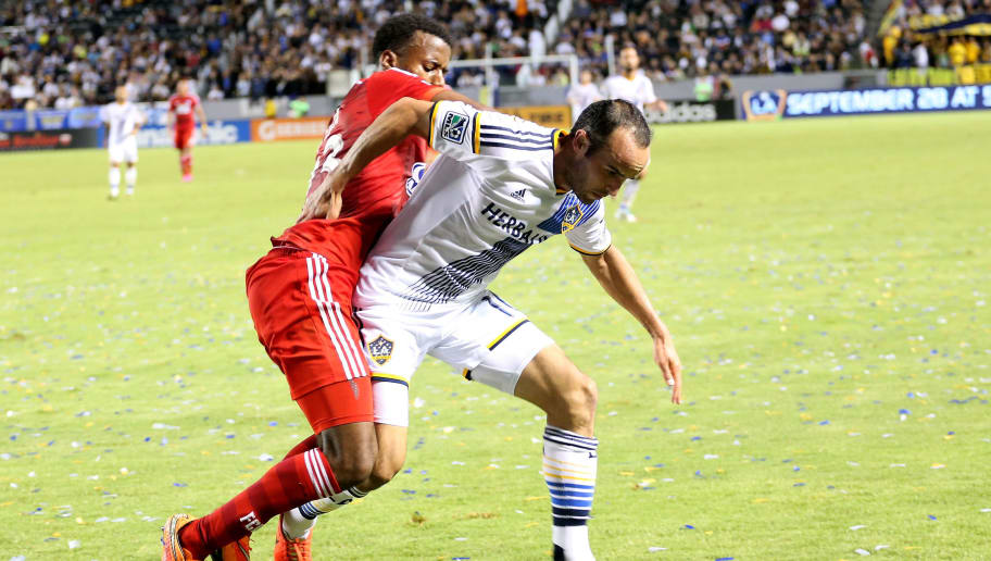 LOS ANGELES, CA - SEPTEMBER 20: Landon Donovan #10 of the Los Angeles Galaxy is brought down by Kellyn Acosta #23 of FC Dallas at StubHub Center on September 20, 2014 in Los Angeles, California.  (Photo by Stephen Dunn/Getty Images)
