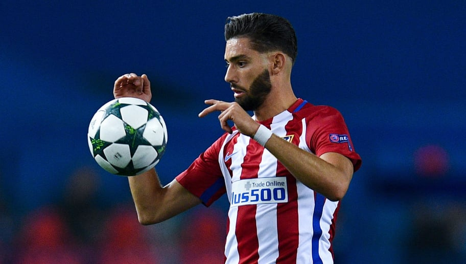 MADRID, SPAIN - SEPTEMBER 28:  Yannick Carrasco of Club Atletico de Madrid runs with the ball during the UEFA Champions League Group D match between Club Atletico de Madrid and FC Bayern Muenchen at Vicente Calderon Stadium on September 28, 2016 in Madrid, Spain.  (Photo by David Ramos/Getty Images)