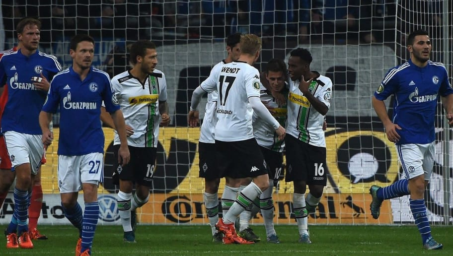Moenchengladbach's Belgian midfielder Thorgan Hazard (3rd R) celebrates scoring a penalty with his team-mates during the German Cup DFB second round football match Schalke 04 vs Borussia Moenchengladbach in Gelsenkirchen, western Germany on October 28, 2015. AFP PHOTO / PATRIK STOLLARZ  RESTRICTIONS / EMBARGO  ACCORDING TO DFB RULES IMAGE SEQUENCES TO SIMULATE VIDEO IS NOT ALLOWED DURING MATCH TIME. MOBILE (MMS) USE IS NOT ALLOWED DURING AND FOR FURTHER TWO HOURS AFTER THE MATCH. FOR MORE INFORMATION CONTACT DFB DIRECTLY AT +49 69 67880.        (Photo credit should read PATRIK STOLLARZ/AFP/Getty Images)