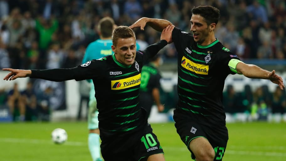 Moenchengladbach's Belgian midfielder Thorgan Hazard (L) celebrates after scoring the opening goal with Moenchengladbach's forward Lars Stindl during the UEFA Champions League first-leg group C football match between Borussia Moenchengladbach and FC Barcelona at the Borussia Park in Moenchengladbach, western Germany on September 28, 2016.  / AFP / Odd ANDERSEN        (Photo credit should read ODD ANDERSEN/AFP/Getty Images)