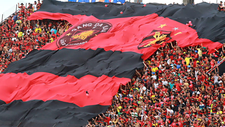 RECIFE, BRAZIL - NOVEMBER 2: Fans of Sport Recife cheer before a match between Sport Recife and Figueirense as part of Brasileirao Series A 2014 at Ilha do Retiro  Stadium on November 2, 2014 in Recife, Brazil. (Photo by Renato Spencer/Getty Images)