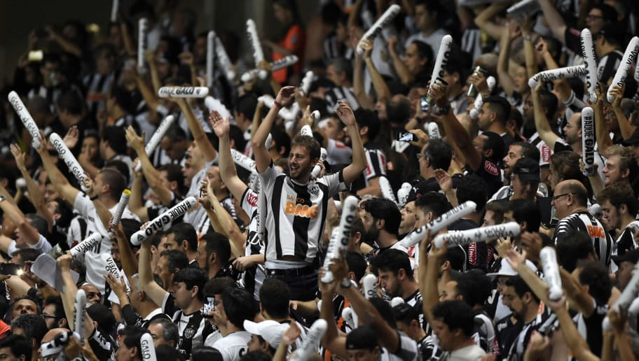 Atletico Mineiro fans cheer before the start of their Libertadores Cup 2016 football match against Sao Paulo at Independencia Stadium in Belo Horizonte, Brazil on May 18, 2016. / AFP / DOUGLAS MAGNO        (Photo credit should read DOUGLAS MAGNO/AFP/Getty Images)