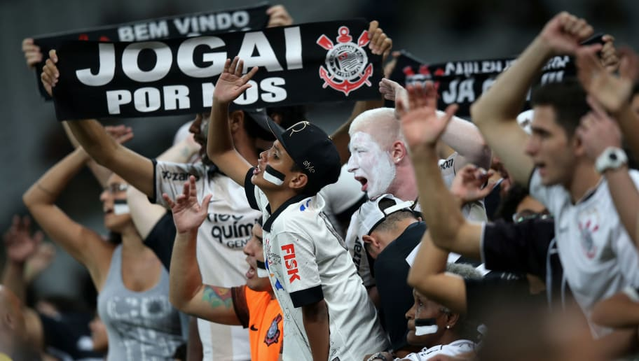 SAO PAULO, BRAZIL - APRIL 20:  Fans of Corinthians celebrates during a match between Corinthians and Cobresal as part of Group 8 of Copa Bridgestone Libertadores at Arena Corinthians on April 20, 2016 in Sao Paulo, Brazil.  (Photo by Friedemann Vogel/Getty Images)