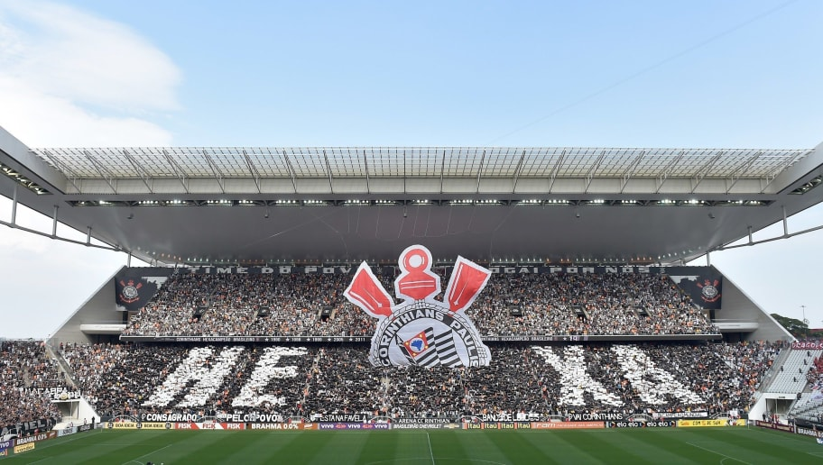 Fans of Corinthians cheer for their team during their Brazilian championship football match against Sao Paulo at Arena Corinthians stadium in Sao Paulo, Brazil, on November 22, 2015. AFP PHOTO / Nelson ALMEIDA        (Photo credit should read NELSON ALMEIDA/AFP/Getty Images)