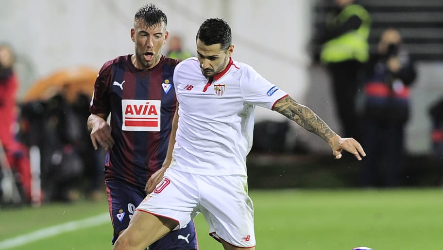 Sevilla's midfielder Vitolo (R) vies with Eibar's forward Sergi Enrich during the Spanish league football match SD Eibar vs Sevilla FC at the Ipurua stadium in Eibar on September 17, 2016. The game ended with a draw 1-1. / AFP / ANDER GILLENEA        (Photo credit should read ANDER GILLENEA/AFP/Getty Images)