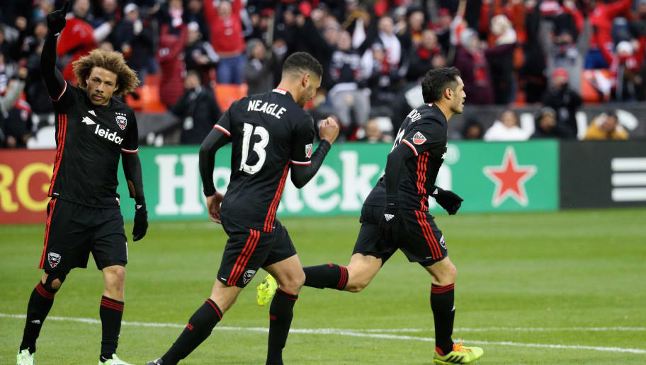 WASHINGTON, DC - MARCH 20: Nick DeLeon #14 and Lamar Neagle #13 celebrate a second half goal by Fabian Espindola #10 of D.C. United (R) against the Colorado Rapids at RFK Stadium on March 20, 2016 in Washington, DC.  (Photo by Rob Carr/Getty Images)