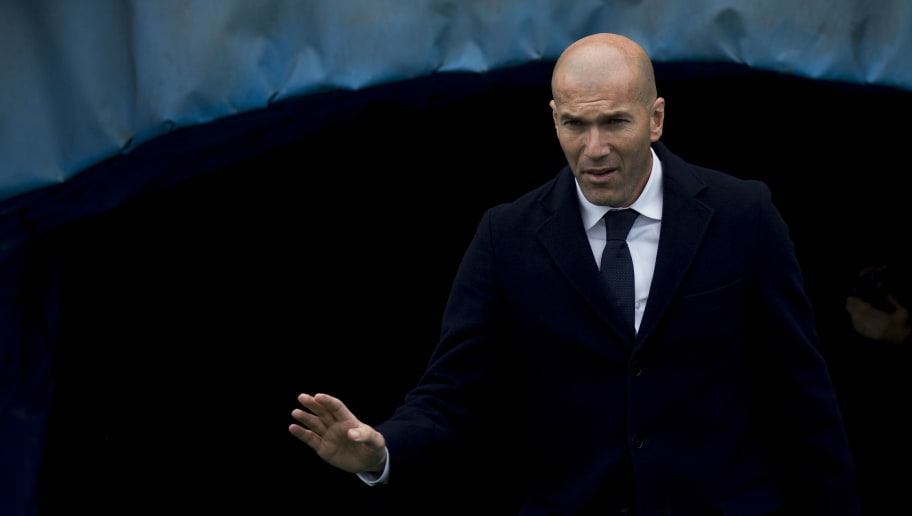 GETAFE, SPAIN - APRIL 16: Head coach Zinedine Zidane of Real Madrid CF waves a s enters the pithc prior to start  the La Liga match between Getafe CF and Real Madrid CF at Coliseum Alfonso Perez on April 16, 2016 in Getafe, Spain.  (Photo by Gonzalo Arroyo Moreno/Getty Images)