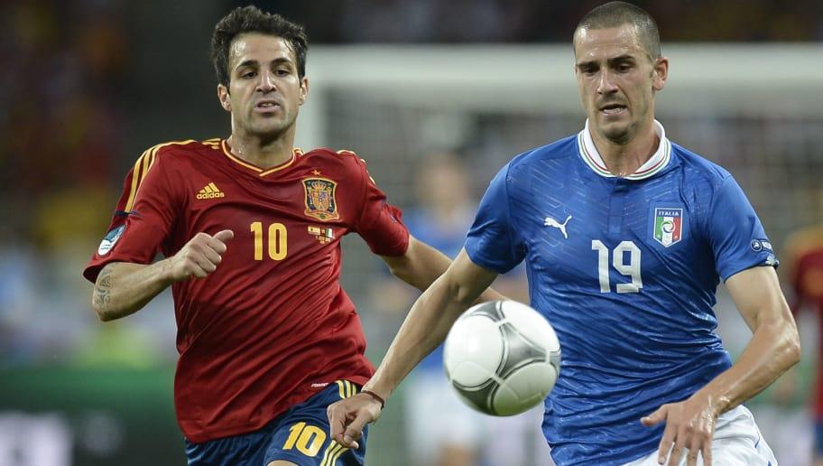 Spanish midfielder Cesc Fabregas (L) vies with Italian defender Leonardo Bonucci during the Euro 2012 football championships final match Spain vs Italy on July 1, 2012 at the Olympic Stadium in Kiev.      AFP PHOTO / FILIPPO MONTEFORTE        (Photo credit should read FILIPPO MONTEFORTE/AFP/GettyImages)