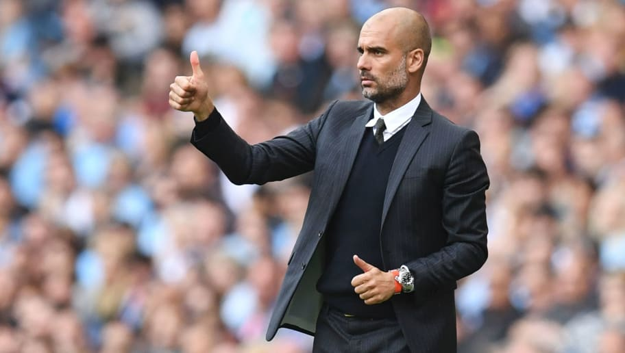 Manchester City's Spanish manager Pep Guardiola gives a thumbs up from the touchline during the English Premier League football match between Manchester City and Bournemouth at the Etihad Stadium in Manchester, north west England, on September 17, 2016. / AFP / PAUL ELLIS / RESTRICTED TO EDITORIAL USE. No use with unauthorized audio, video, data, fixture lists, club/league logos or 'live' services. Online in-match use limited to 75 images, no video emulation. No use in betting, games or single club/league/player publications.  /         (Photo credit should read PAUL ELLIS/AFP/Getty Images)