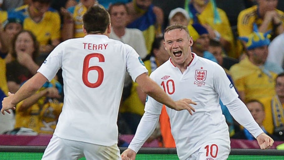 English forward Wayne Rooney (R) and English defender John Terry celebrate after scoring during the Euro 2012 football championships match England vs Ukraine on June 19, 2012 at the Donbass Arena in Donetsk.      AFP PHOTO / PATRICK HERTZOG        (Photo credit should read PATRICK HERTZOG/AFP/GettyImages)