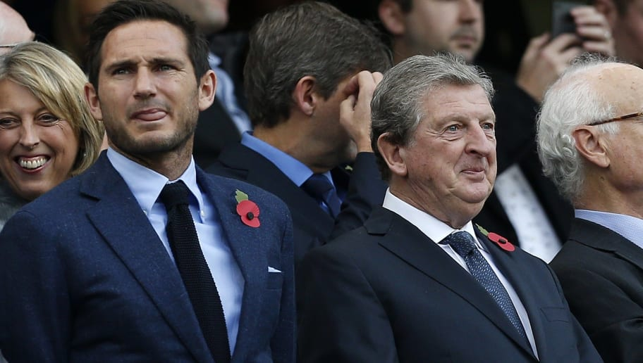 Former Chelsea player Frank Lampard (L) stands in the crowd alongside England manager Roy Hodgson ahead of the English Premier League football match between Chelsea and Liverpool at Stamford Bridge in London on October 31, 2015. AFP PHOTO / IAN KINGTON  RESTRICTED TO EDITORIAL USE. No use with unauthorized audio, video, data, fixture lists, club/league logos or 'live' services. Online in-match use limited to 75 images, no video emulation. No use in betting, games or single club/league/player publications.        (Photo credit should read IAN KINGTON/AFP/Getty Images)