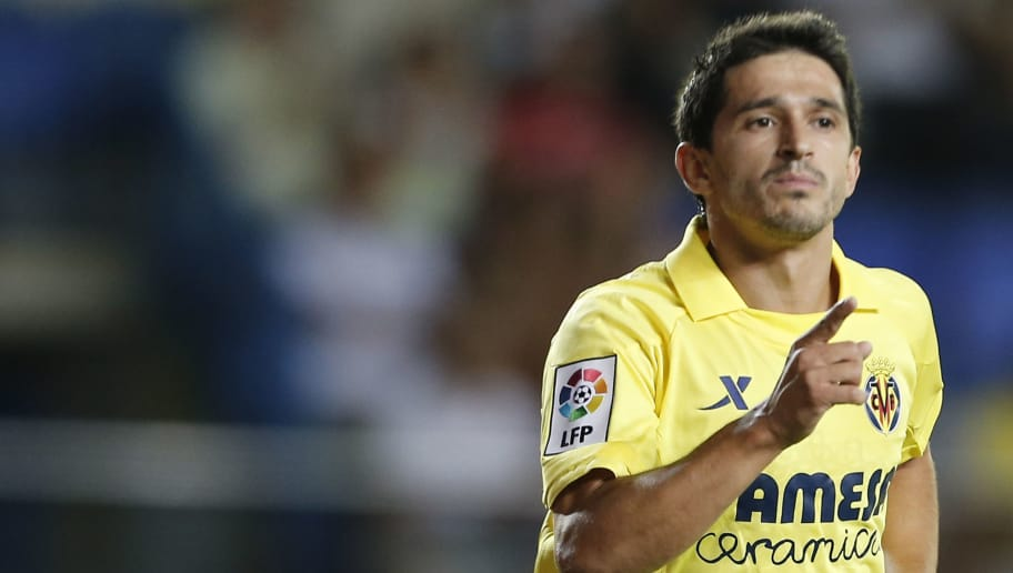 Villarreal's forward Jonathan Pereira celebrates after scoring during the Trofeo de la Ceramica (Ceramic Trophy) football match Villarreal CF vs ACF Fiorentina at El Madrigal stadium in Villareal on August 8, 2013.  AFP PHOTO / JOSE JORDAN        (Photo credit should read JOSE JORDAN/AFP/Getty Images)
