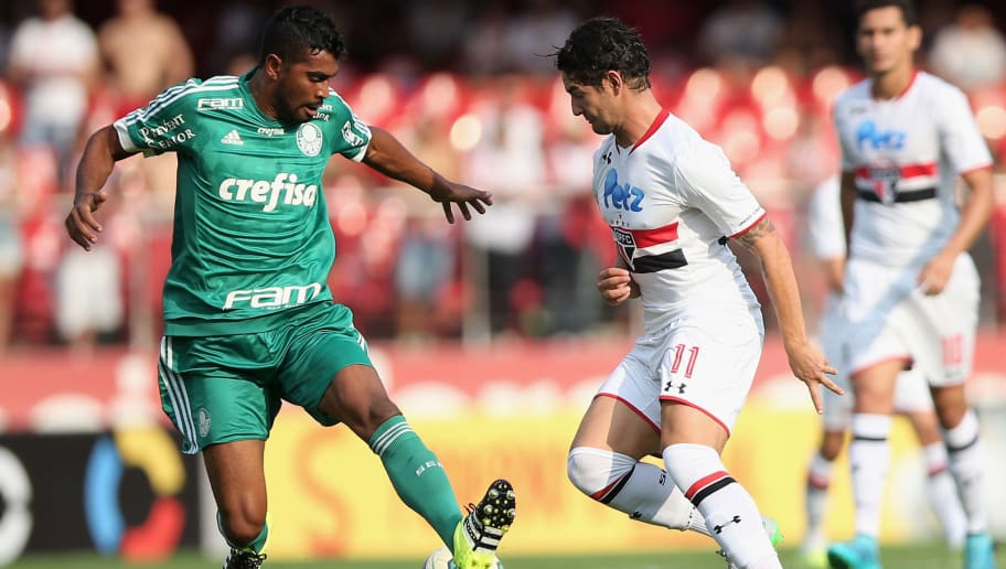 SAO PAULO, BRAZIL - SEPTEMBER 27:  Pato (R) of Sao Paulo fights for the ball with Thiago Santos (L) of Palmeiras during the match between Sao Paulo and Palmeiras for the Brazilian Series A 2015 at Estadio do Morumbi on September 27, 2015 in Sao Paulo, Brazil.  (Photo by Friedemann Vogel/Getty Images)