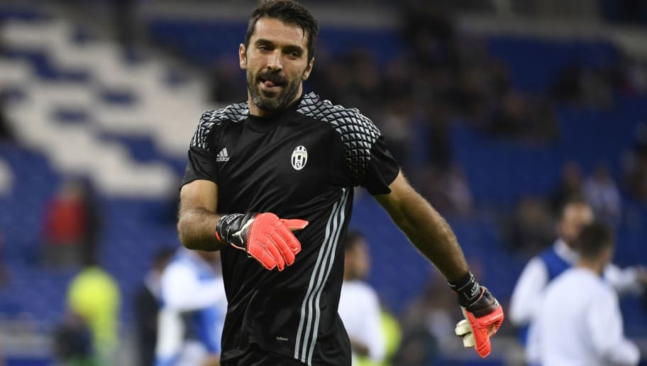 CORRECTION - Juventus' Italian goalkeeper Gianluigi Buffon warms up prior to the Champions League football match between Olympique Lyonnais and Juventus on October 18, 2016  at the Parc Olympique Lyonnais stadium in Decines-Charpieu near Lyon, southeastern France.    / AFP / PHILIPPE DESMAZES / The erroneous mention[s] appearing in the metadata of this photo by PHILIPPE DESMAZES has been modified in AFP systems in the following manner: [Juventus' Italian goalkeeper Gianluigi Buffon ] instead of [Juventus' Italian LEGAL & GENERAL GROUP Buffon]. Please immediately remove the erroneous mention[s] from all your online services and delete it (them) from your servers. If you have been authorized by AFP to distribute it (them) to third parties, please ensure that the same actions are carried out by them. Failure to promptly comply with these instructions will entail liability on your part for any continued or post notification usage. Therefore we thank you very much for all your attention and prompt action. We are sorry for the inconvenience this notification may cause and remain at your disposal for any further information you may require.        (Photo credit should read PHILIPPE DESMAZES/AFP/Getty Images)
