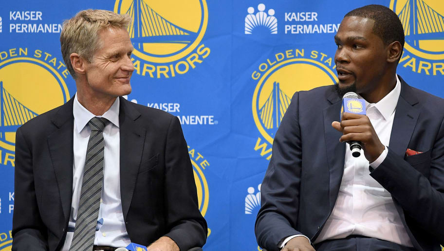 OAKLAND, CA - JULY 07:  (L-R) Head coach Steve Kerr of the Golden State Warriors sits with Kevin Durant while they speak to the media during the press conference where Durant was introduced as a Golden State Warrior after they signed him as a free agent on July 7, 2016 in Oakland, California.  (Photo by Thearon W. Henderson/Getty Images)