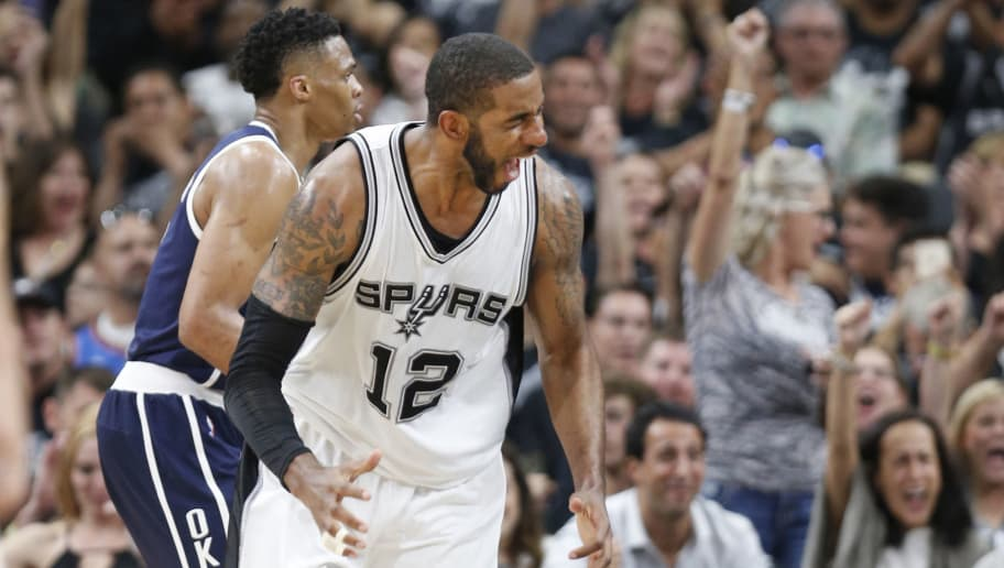 SAN ANTONIO,TX - APRIL 30: LaMarcus Aldridge  #12 of the San Antonio Spurs celebrates after a score against the Oklahoma City Thunder during game one of the Western Conference Semifinals for the 2016 NBA Playoffs at AT&T Center on April 30, 2016 in San Antonio, Texas.  NOTE TO USER: User expressly acknowledges and agrees that , by downloading and or using this photograph, User is consenting to the terms and conditions of the Getty Images License Agreement. (Photo by Ronald Cortes/Getty Images)