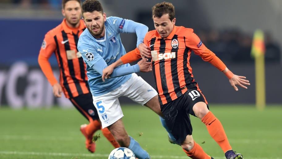 Malmo FF s Swedish midfielder Erdal Rakip (L) vies with Shakhtar Donetsk s  Brazilian midfielder Bernard 52bb58c2ce053