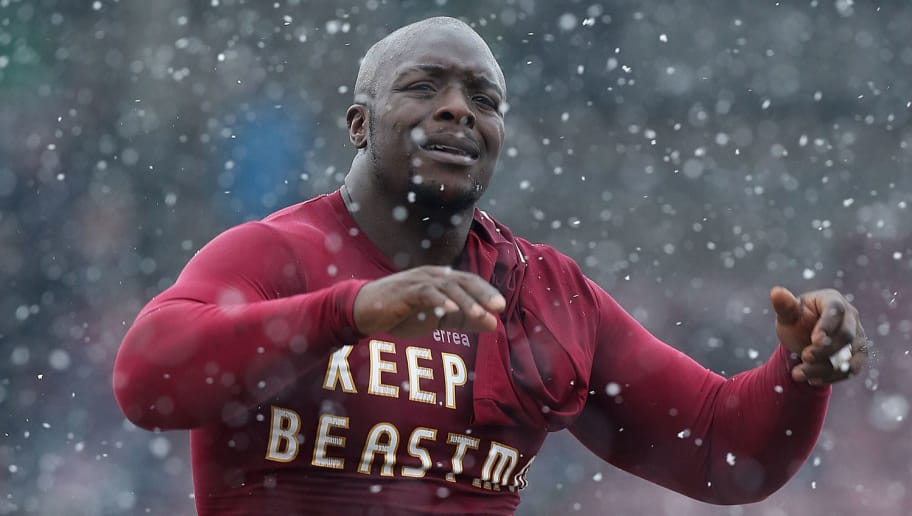 NORTHAMPTON, ENGLAND - MARCH 23:  Adebayo Akinfenwa of Northampton Town leaves the pitch at the end of the npower League Two match between Northampton Town and Oxford United at Sixfields Stadium on March 23, 2013 in Northampton, England.  (Photo by Pete Norton/Getty Images)