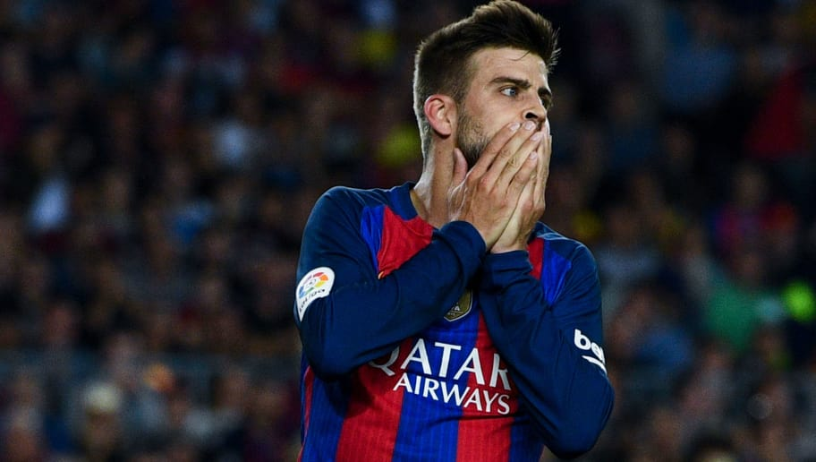 BARCELONA, SPAIN - SEPTEMBER 21:  Gerard Pique of FC Barcelona reacts after missing a chance to score during the La Liga match between FC Barcelona and Club Atletico de Madrid at the Camp Nou stadium on September 21, 2016 in Barcelona, Spain.  (Photo by David Ramos/Getty Images)