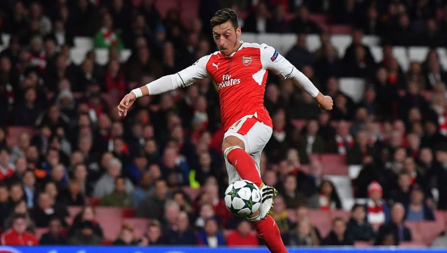 Arsenal's German midfielder Mesut Ozil shoots to score his hat trick, and his teams sixth goal, during the UEFA Champions League Group A football match between Arsenal and Ludogorets Razgrad at The Emirates Stadium in London on October 19, 2016. / AFP / BEN STANSALL        (Photo credit should read BEN STANSALL/AFP/Getty Images)