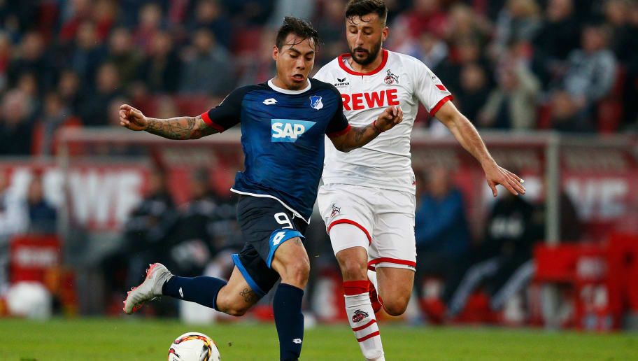 COLOGNE, GERMANY - OCTOBER 31:  Eduardo Vargas of Hoffenheim battles for the ball with Dominic Maroh of koeln during the Bundesliga match between 1. FC Koeln and TSG 1899 Hoffenheim held at RheinEnergieStadion on October 31, 2015 in Cologne, Germany.  (Photo by Dean Mouhtaropoulos/Bongarts/Getty Images)