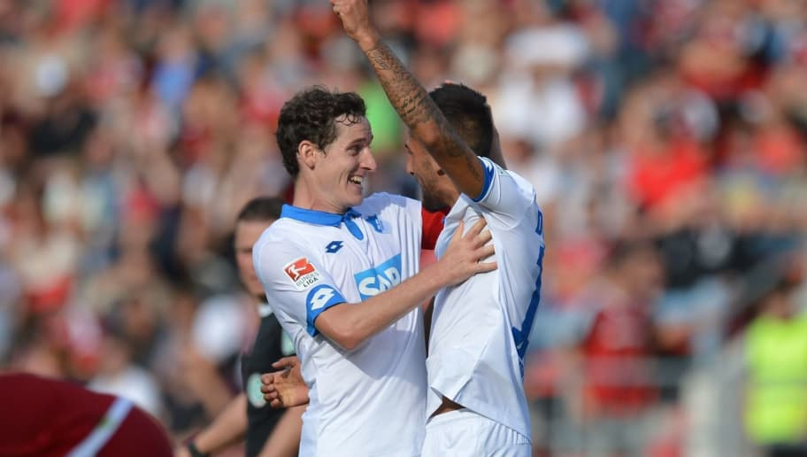 INGOLSTADT, GERMANY - OCTOBER 01: Kerem Demirbay (R) of Hoffenheim celebrates with Sebastian Rudy of Hoffenheim after scoring his team's second goal during the Bundesliga match between FC Ingolstadt 04 and TSG 1899 Hoffenheim at Audi Sportpark on October 1, 2016 in Ingolstadt, Germany.  (Photo by Micha Will/Bongarts/Getty Images)