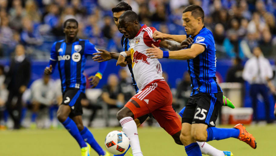 MONTREAL, QC - MARCH 12: Donny Toia #25 of the Montreal Impact challenges Bradley Wright-Phillips #99 of the New York Red Bulls during the MLS game at the Olympic Stadium on March 12, 2016 in Montreal, Quebec, Canada. (Photo by Minas Panagiotakis/Getty Images)