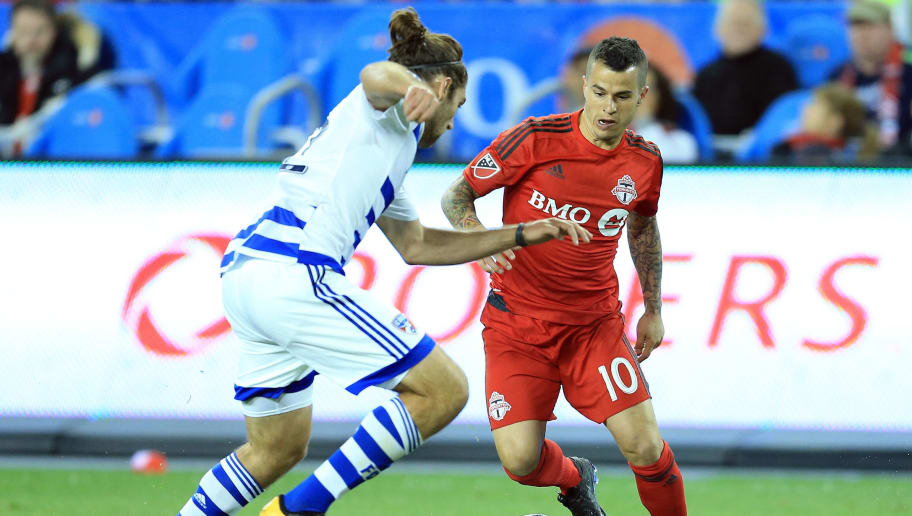 TORONTO, ON - MAY 07:  Sebastian Giovinco #10 of Toronto FC battles for the ball with Ryan Hollingshead #12 of FC Dallas during the second half of an MLS soccer game at BMO Field on May 7, 2016 in Toronto, Ontario, Canada.  (Photo by Vaughn Ridley/Getty Images)