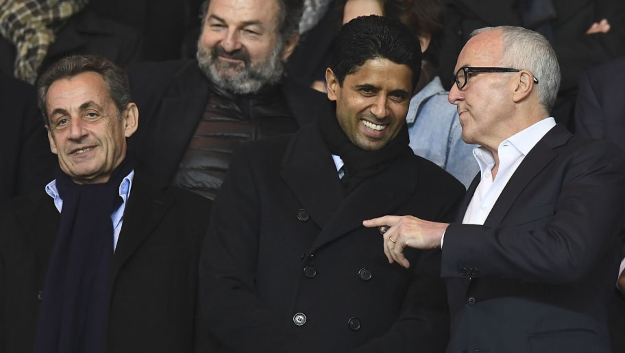 Paris Saint-Germain's Qatari President Nasser Al-Khelaifi (C) speaks with Olympique de Marseille's new owner Frank McCourt (R) next to former French president Nicolas Sarkozy during the French L1 football match between Paris Saint-Germain and Olympique of Marseille at the Parc des Princes stadium in Paris on October 23, 2016. / AFP / FRANCK FIFE        (Photo credit should read FRANCK FIFE/AFP/Getty Images)