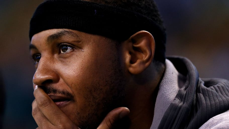 BOSTON, MA - OCTOBER 17:  Carmelo Anthony #7 of the New York Knicks looks on from the bench during the first quarter against the Boston Celtics at TD Garden on October 17, 2016 in Boston, Massachusetts.  (Photo by Maddie Meyer/Getty Images)