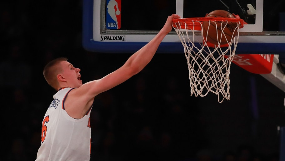 NEW YORK, NY - OCTOBER 10:  Kristaps Porzingis #6 of the New York Knicks slams a dunk home in the first half against the Washington Wizards during the preseason game at Madison Square Garden on October 10, 2016 in New York City. NOTE TO USER: User expressly acknowledges and agrees that, by downloading and or using this photograph, User is consenting to the terms and conditions of the Getty Images License Agreement.  (Photo by Michael Reaves/Getty Images)
