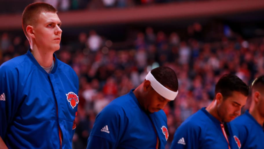 NEW YORK, NY - OCTOBER 29:  Kristaps Porzingis #6, Carmelo Anthony #7 and Sasha Vujacic #18 of the New York Knicks pause for the national anthem prior to the game against the Memphis Grizzlies at Madison Square Garden on October 29, 2016 in New York City. NOTE TO USER: User expressly acknowledges and agrees that, by downloading and or using this photograph, User is consenting to the terms and conditions of the Getty Images License Agreement.  (Photo by Michael Reaves/Getty Images)