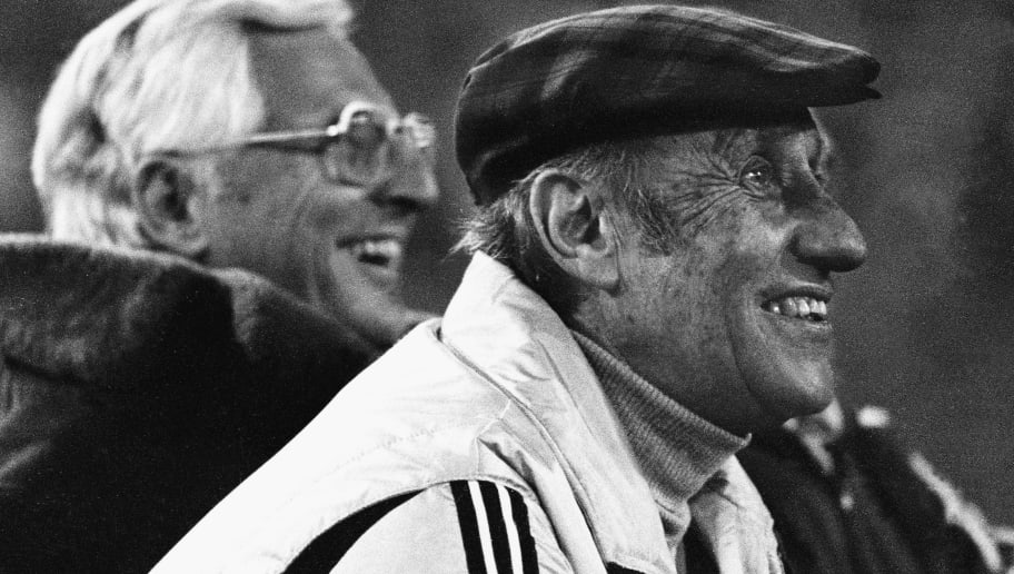 FRANKFURT, GERMANY - NOVEMBER 12: Head coach Jupp Derwall (L) and former head coach Helmut Schoen of Germany look on during the farewell match for Juergen Grabowski between Eintracht Frankfurt and the German World Champion Team of 1974 at the Waldstadium on November 12, 1980 in Frankfurt, Germany. (Photo by Lutz Bongarts/Bongarts/Getty Images)
