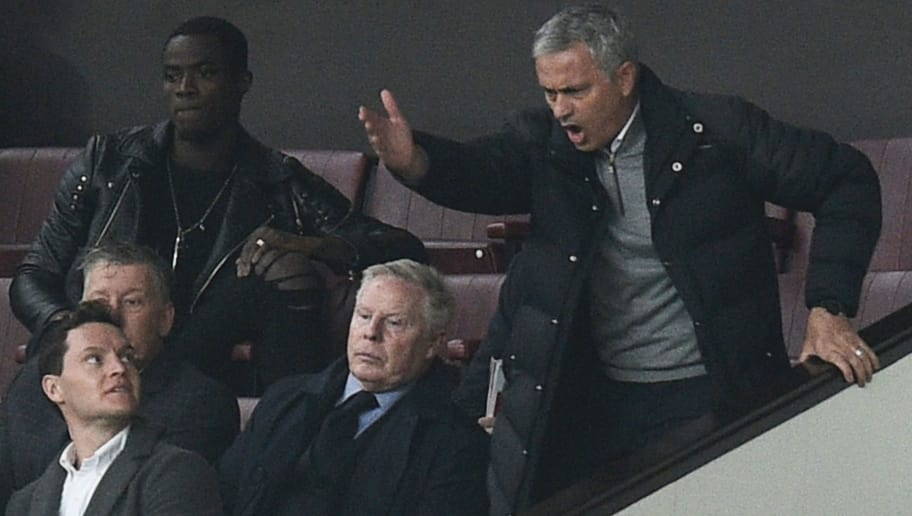 Manchester United's Portuguese manager Jose Mourinho (R) gestures and shouts in the Directors Box after being sent off to the stands during the English Premier League football match between Manchester United and Burnley at Old Trafford in Manchester, north west England, on October 29, 2016. / AFP / OLI SCARFF / RESTRICTED TO EDITORIAL USE. No use with unauthorized audio, video, data, fixture lists, club/league logos or 'live' services. Online in-match use limited to 75 images, no video emulation. No use in betting, games or single club/league/player publications.  /         (Photo credit should read OLI SCARFF/AFP/Getty Images)