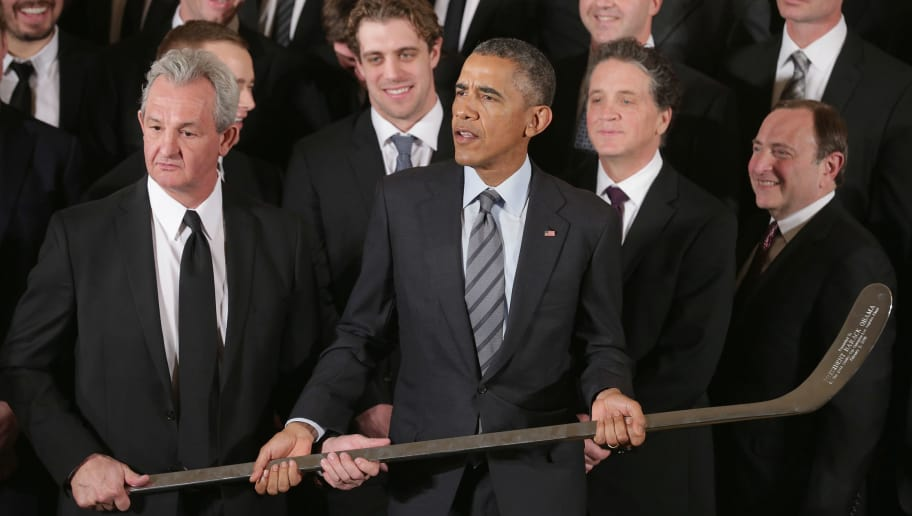 WASHINGTON, DC - FEBRUARY 02:  Los Angeles Kings Head Coach Darryl Sutter (L) presents U.S. President Barack Obama with a silver hockey stick as Obama hosted the National Hockey League champions in the East Room of the White House February 2, 2015 in Washington, DC. Obama simultaneously hosted the Major League Soccer champions Los Angeles Galaxy. Both teams are owned in part by billionaire and The Weekly Standard publisher Philip Anschutz.  (Photo by Chip Somodevilla/Getty Images)