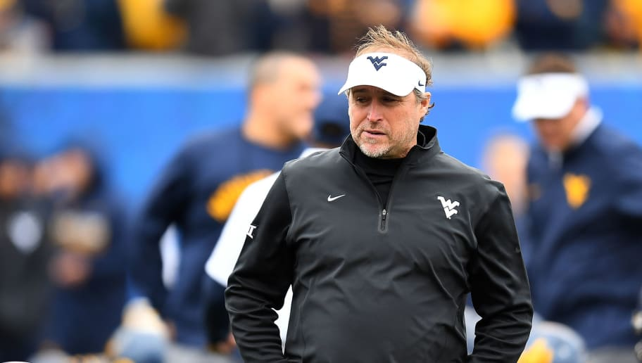 MORGANTOWN, WV - OCTOBER 22:  Head coach Dana Holgorsen of the West Virginia Mountaineers looks on during warmups prior to the game against the TCU Horned Frogs  at Mountaineer Field on October 22, 2016 in Morgantown, West Virginia. (Photo by Joe Sargent/Getty Images)