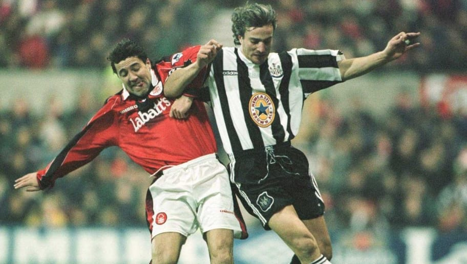 9 Dec 1996: Dean Saunders of Forest battles with David Ginola of Newcastle  during the Nottingham Forest v Newcastle United FA Carling Premiership match at the City Ground in Nottingham, Great Britain. Mandatory Credit: Graham Chadwick/Allsport